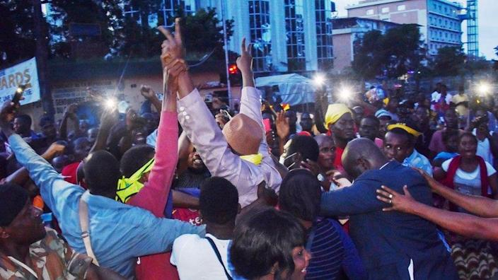 Supporters and ex-prisoners celebrating.