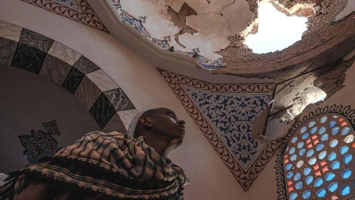 An Ethiopian Muslim stands inside a damaged mausoleum at the al-Negashi Mosque, one of the oldest in Africa and allegedly damaged by shelling, in Negash - March 2021