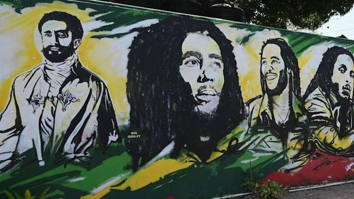 A mural depicting Ethiopian Emperor Haile Selassie I, Jamaican Reggae legend Bob Marley and his sons at grounds of the Bob Marley Museum in Kingston, Jamaica, on May 2019