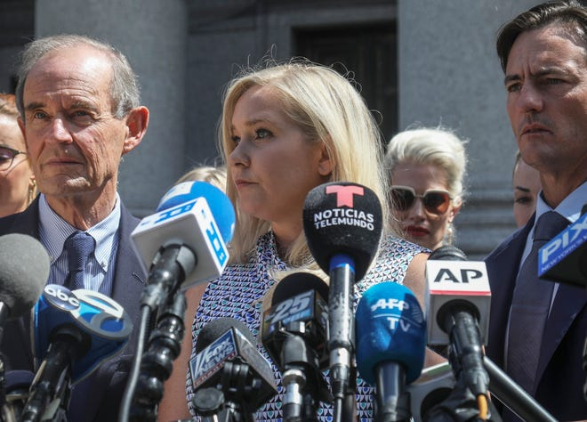Virginia Giuffre, center, who says she was trafficked by sex offender Jeffrey Epstein, sued Prince Andrew saying he sexually assaulted her when she was 17.