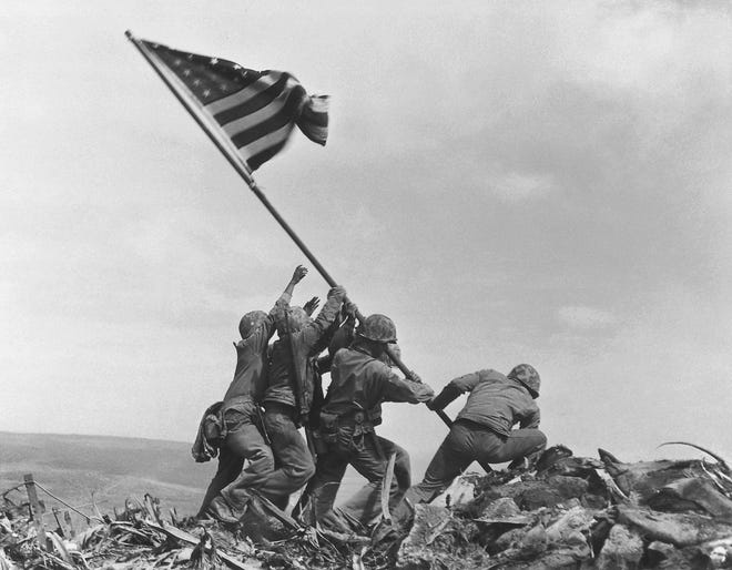 In this Feb 23, 1945 file photo, U.S. Marines of the 28th Regiment, 5th Division, raise the American flag atop Mt. Suribachi, Iwo Jima, Japan.