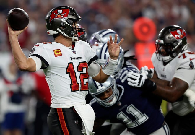 Tom Brady threw for four touchdowns in the Buccaneers' season-opening win.