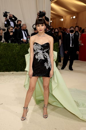 """Gemma Chan attends the 2021 Met Gala celebrating """"In America: A Lexicon Of Fashion"""" at the Metropolitan Museum of Art on Sept. 13, 2021 in New York City."""
