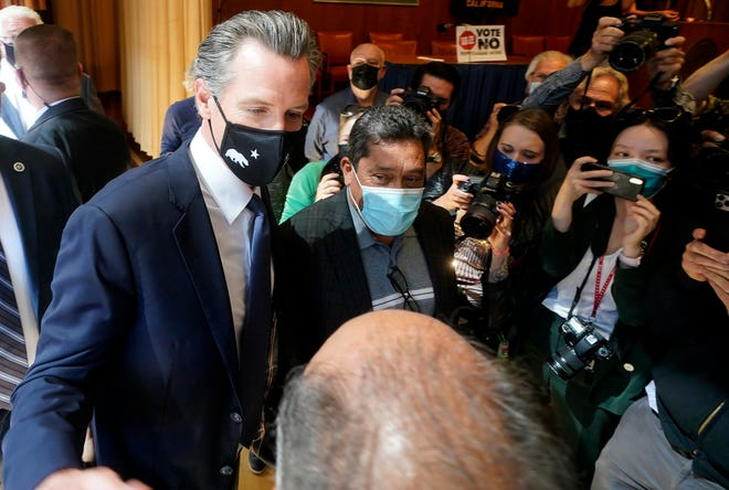 Gov. Gavin Newsom greets supporters after speaking to volunteers in San Francisco on Tuesday.