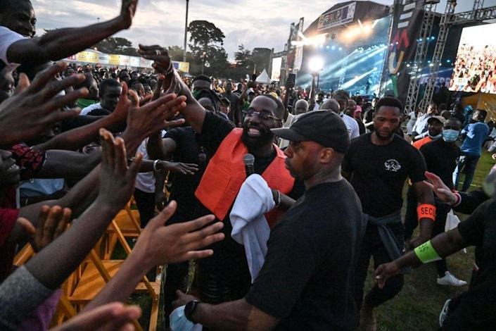 Franco-Ivorian singer Vegedream interacts with fans as he performs at the festival.