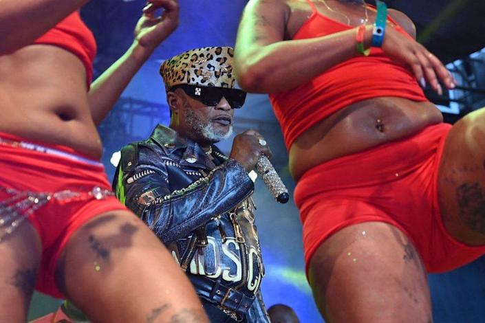 Koffi Olomide performs on stage at the festival with dancers and back-up musicians on 12 September.