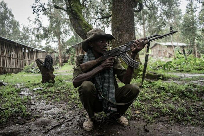 An Amhara militia member poses for a photograph near the village of Chenna, 95km north-east of the city of Gondar.