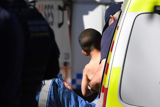 Three-year-old AJ Elfalak is carried by a paramedic into an ambulance after he is found alive on the family property near Putty, northwest of Sydney, Australia, on Sept. 6, 2021.
