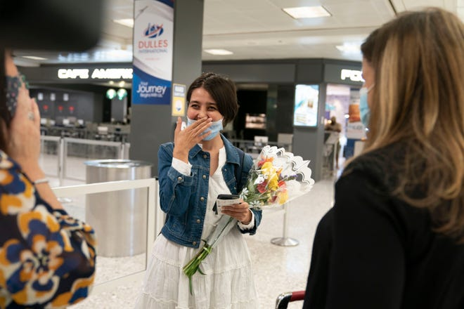 Afghan journalist Fatema Hosseini is greeted by USA TODAY Editor in Chief Nicole Carroll and publisher Maribel Wadsworth at Dulles International Airport after being evacuated from Kabul.