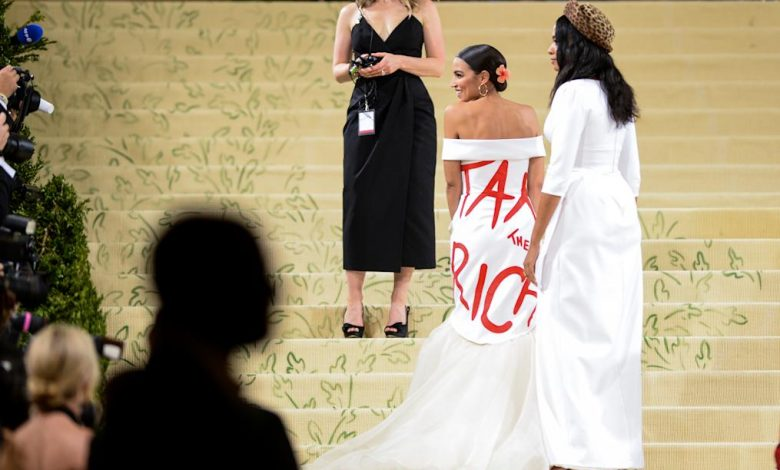 Alexandria Ocasio-Cortez's Met Gala gown message sparked controversy. Why 'slogan fashion' is returning to red carpets