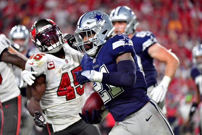 Ezekiel Elliott of the Dallas Cowboys carries the ball against the Tampa Bay Buccaneers during the fourth quarter at Raymond James Stadium on September 09, 2021 in Tampa, Florida.