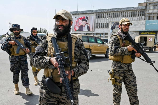 Members of the Taliban Badri 313 military unit arrive at the airport in Kabul on Aug. 31, 2021, after the US has pulled all its troops out of the country to end a brutal 20-year war -- one that started and ended with the hardline Islamist in power.