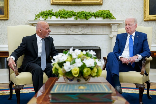 President Joe Biden, right, meets with Afghan President Ashraf Ghani, left, in the Oval Office of the White House in Washington, Friday, June 25, 2021. (AP Photo/Susan Walsh) ORG XMIT: otkw102