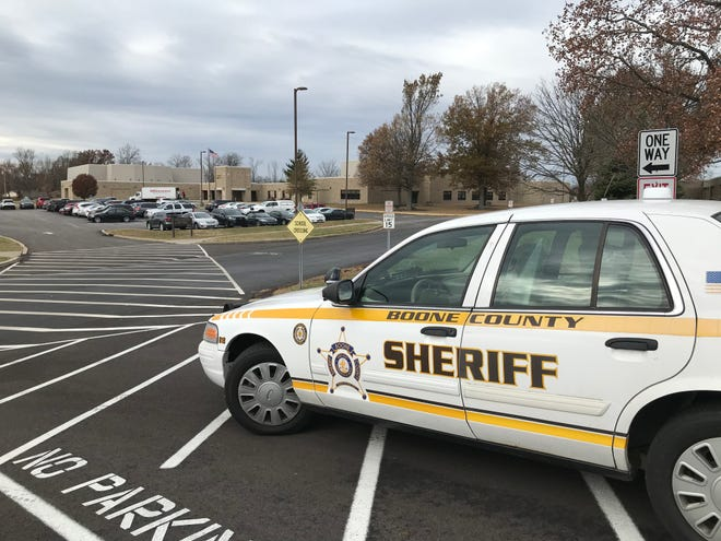 On Nov. 21, 2019, a Boone County Sheriff car parked near the entrance to the campus of Ockerman Middle School in Florence, Kentucky, a day after a 13-year-old student was arrested on a felony terroristic threatening charge. Police said the boy reportedly threatened to shoot three eighth grade girls and seventh-grade students in general. Nationwide, roughly a quarter of law enforcement referrals lead to arrests, federal data shows.