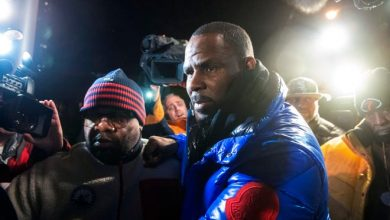 R. Kelly surrenders to Chicago police in 2019, hours after he was charged with 10 counts of aggravated criminal sexual abuse.