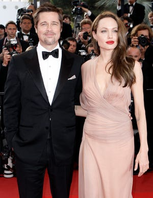 """Brad Pitt and Angelina Jolie in happier days, arriving on the red carpet for """"Inglourious Basterds"""" at Cannes Film Festival in France on May 20, 2009."""