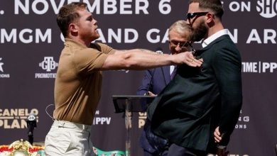 Canelo Alvarez, left, shoves Caleb Plant during a news conference Tuesday in Beverly Hills to announce their 168-pound title bout on Nov. 6.
