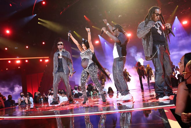 Cardi B and Quavo, Offset, and Takeoff of Migos perform onstage at the 2021 BET Awards.