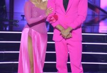 """""""Dancing with the Stars"""" pro Cheryl Burke stands with Peloton instructor Cody Rigsby."""