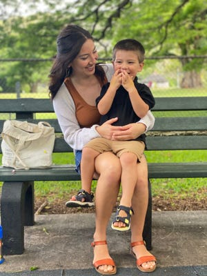 Joanna Lara, 27, plays with her 3-year-old son at a park in Honolulu.