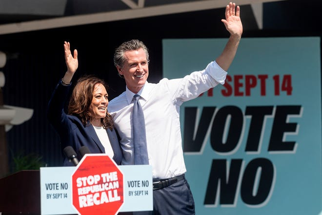 Vice President Kamala Harris and California Gov. Gavin Newsom wave to supporters on Wednesday during a rally against the California gubernatorial recall election in San Leandro, Calif.