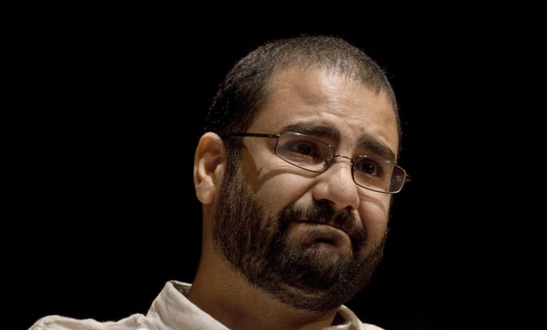 Egyptian activist stands trial after 19-month detention
