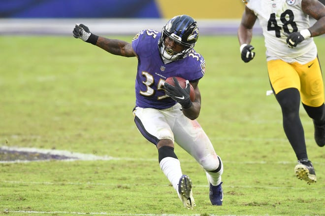 Baltimore Ravens running back Gus Edwards suffered a serious knee injury during Thursday's practice.