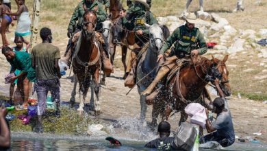 U.S. Customs and Border Patrol agents on horseback try to stop Haitian migrants from entering an encampment on the banks of the Rio Grande near the Acuna Del Rio International Bridge in Del Rio, Texas on Sept. 19, 2021.