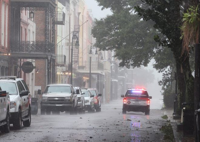 A police car cruises through the French Quarter during Hurricane Ida in New Orleans.