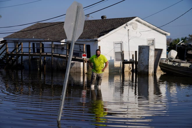 """Nathan Fabre checks on his home and boat destroyed by Hurricane Ida, Sunday, Sept. 5, 2021, in Lafitte, La. """"We lost everything,"""" Fabre said."""