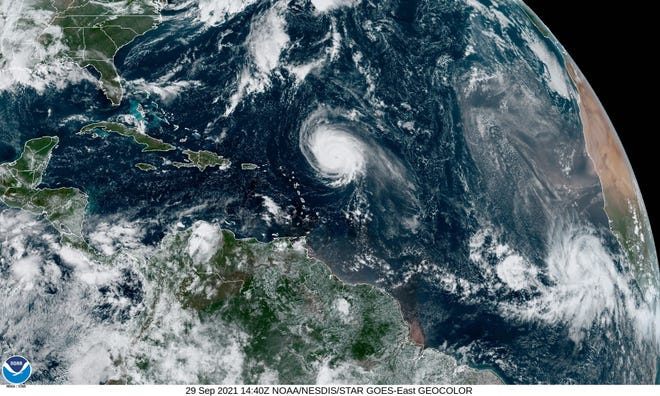A satellite image from Wednesday Sept. 29, 2021, shows Hurricane Sam (center) spinning in the Atlantic Ocean a few hundred miles from the Leeward Islands of the Caribbean.