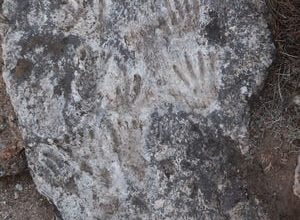 Hand and footprints preserved in limestone on the Tibetan Plateau.