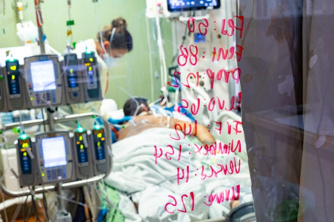 Nurse Ann Enderle checks on a COVID-19 patient in the medical intensive care unit at St. Luke's Boise Medical Center in Boise, Idaho, on Aug. 31, 2021. (AP Photo/Kyle Green)