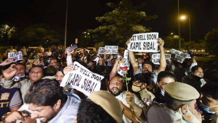 Delhi Congress workers hold placards reading Get Well Soon