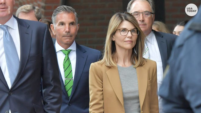 Two and a half years after the college admissions scandal rocked her career, Lori Loughlin is making a return to the acting world. She's pictured here with husband Mossimo Giannulli, left.