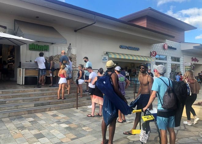 Tourists line up outside the Monkeypod Kitchen by Merriman restaurant at Whaler's Village on Kaanapali Beach in Maui in early July. Beginning Sept. 15, only fully vaccinated patrons will be allowed to dine inside.