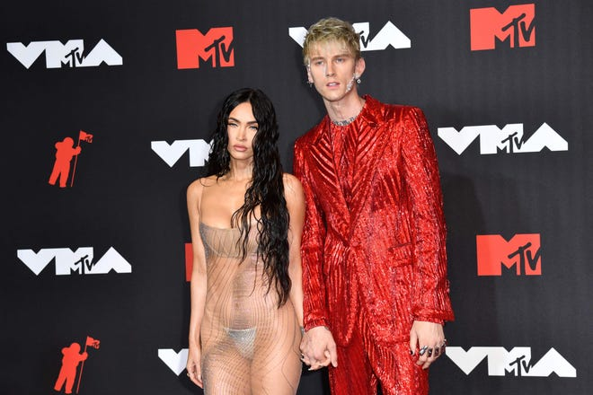 Megan Fox, Machine Gun Kelly arrive for the 2021 MTV Video Music Awards at Barclays Center in Brooklyn, New York.