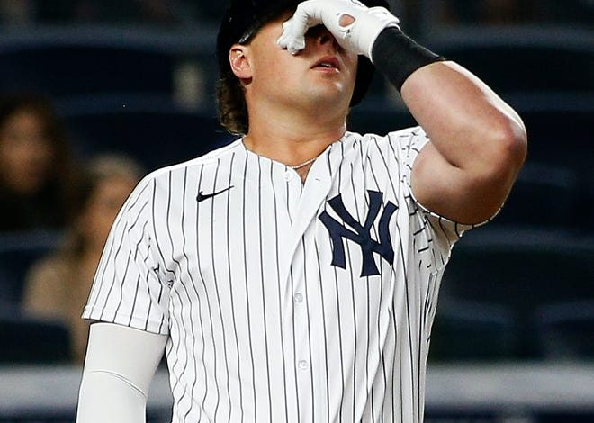 Luke Voit reacts after striking out.
