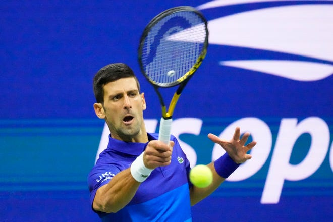 Top seed Novak Djokovic hits a forehand against No. 4 seed Alexander Zverev during Friday's U.S. Open men's semifinal.
