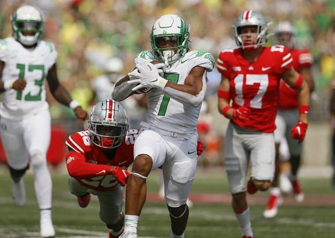 Oregon running back CJ Verdell (7) gets past Ohio State cornerback Cameron Brown on his way to a 77-yard touchdown during the third quarter at Ohio Stadium in Columbus.