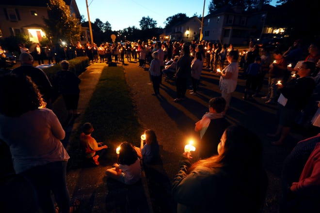 Family and friends of Marcus Gaiters gathered at the corner of Myrtle and Lenox avenues Wednesday evening to pray for the 10-year-old. Gaiters has been battling COVID-19 for more than a month at Children's Hospital.