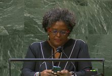 Phone in hand, Barbados PM dials into issues at UN