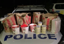 Police bust men smuggling KFC chicken into city locked down for COVID