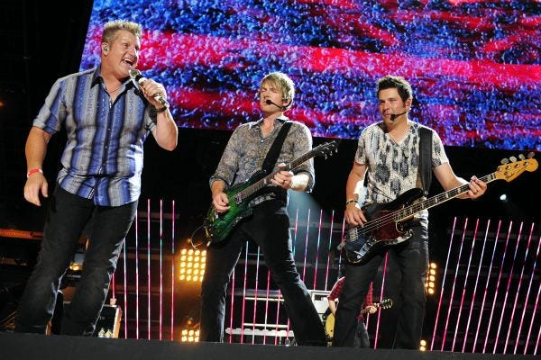 Rascal Flatts performs during the CMA Music Festival June 11, 2011 at LP Field in Nashville.