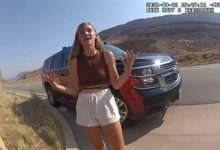 In this file August 12, 2021, still image from a police bodycam released by the Moab City Police Department in Utah, Gabrielle Petito speaks with police as they responded to an altercation between Petito and her boyfriend, Brian Laundrie.