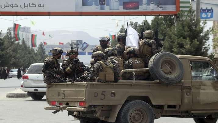 Taliban special force fighters arrive inside the Hamid