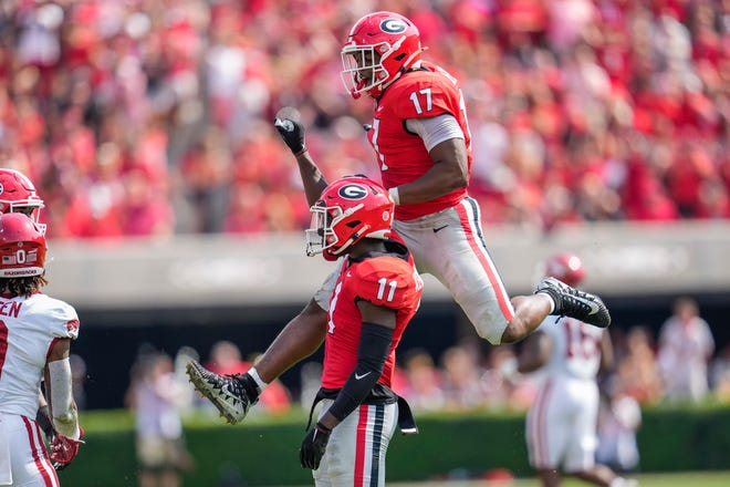 Georgia defensive back Derion Kendrick and linebacker Nakobe Dean react after a play against the Arkansas Razorbacks during the first half at Sanford Stadium.