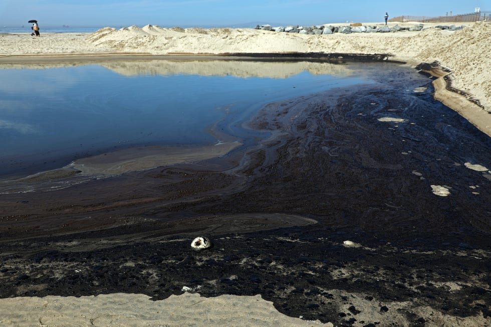 Oil and sea water collect in a tide pool after a 126,000-gallon oil spill from an offshore oil platform on October 3, 2021 in Newport Beach, California. The spill forced the closure of the popular Great Pacific Airshow with authorities urging people to avoid beaches in the vicinity.