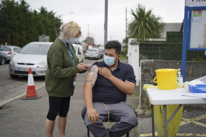 A member of the public receives a Pfizer Covid vaccination at an NHS walk-up vaccination unit outside the village hall on September 25, 2021 in the village of Summercourt, near Newquay, Cornwall, United Kingdom. (Photo by Hugh Hastings/Getty Images)