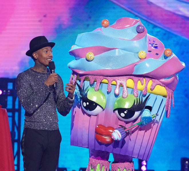 """""""Masked Singer"""" host Nick Cannon with contestant Cupcake."""